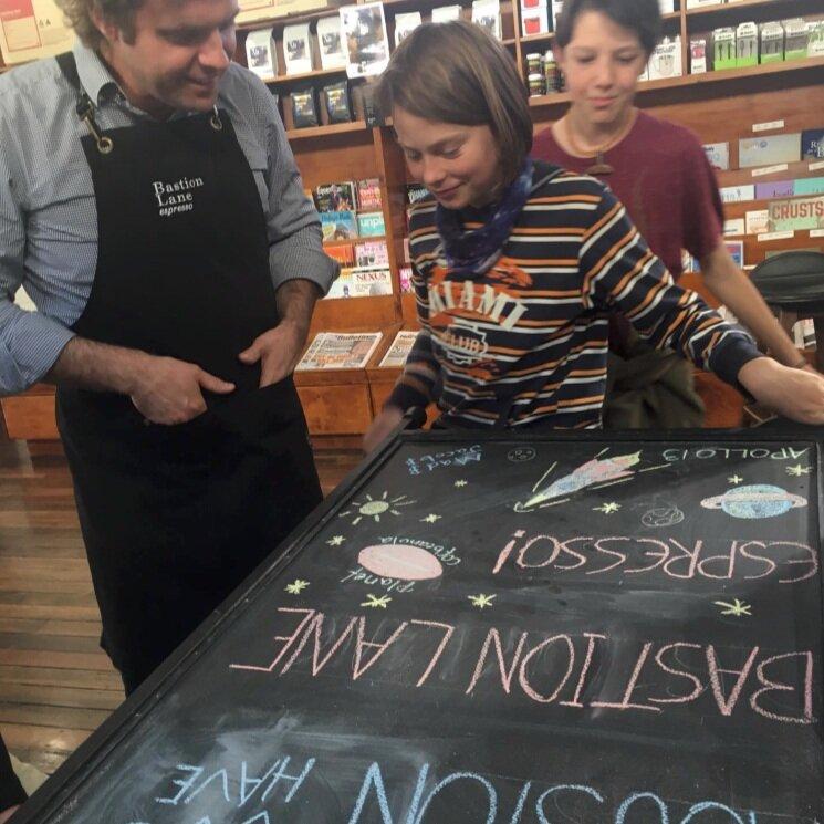 Roast Master Gary with chalk board artists at Bastion Lane Espresso